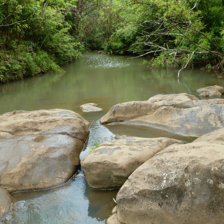 The rocks do not stop the endless flow of water.