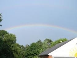 A beautiful faint double rainbow, right in my backyard.